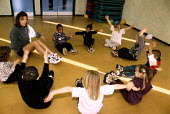 Children in a creche with a teacher doing physical exercises - Janina Struk - 20-06-2000