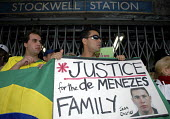 Members of the Brazilian community hold a vigil outside Stockwell Tube Station for Jean Charles de Menezes who was shot dead by police who mistook him for a suicide bomber on 22nd July 2005 - Janina Struk - 25-07-2005