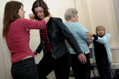 BECTU women receiving instruction and practising during a self-defence workshop at a womens national event. - Janina Struk - 12-11-2005