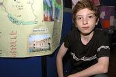 """Refugee pupil from Iran with his """"My Country"""" display at Hampstead school during Refugee Week - Janina Struk - 21-06-2006"""