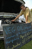 A car mechanic demonstrates how to convert a car engine to run on vegetable oil. - Janina Struk - 09-09-2007
