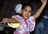 Young girl dressed in theatrical costume, dancing at a performance at the Museum of the Revolution in Havana. - Janina Struk - 20-12-1997