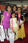Children pose for a photograph at an exhibition about the Islamic world at Islam Expo, Olympia, London. - Janina Struk - 11-07-2008