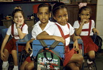 School children in a classroom at the Juan Antonio de Mella Primary School, in Havana. - Janina Struk - 1990s,1997,americas,bag,bags,black,boy,boys,caribbean,child,CHILDHOOD,children,class,classroom,classrooms,cuba,cuban,cubans,desk,desks,edu education,EMOTION,EMOTIONAL,EMOTIONS,female,females,friend,fr