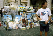 A man wearing a Fidel Castro meets the Pope t-shirt in Plaza de la Catedral (Cathedral Square), at a market for tourists in central Havana. - Janina Struk - 04-01-1998