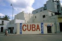 Women walking past Long Live Free Cuba graffiti, Havana - Janina Struk - 1990s,1997,ACE,americas,architecture,arts,building,buildings,caribbean,cities,city,Cuba,cuban,cubans,culture,FEMALE,graffiti,graffito,highway,Latin America,painting,paintings,people,person,persons,pol