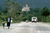 A woman and a child on the road from the Basilica Del Cobre, a church and national shrine. - Janina Struk - 04-01-1998