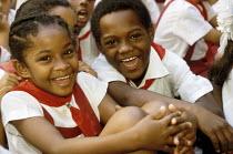 Smiling children at Teachers Day celebrations at the Juan Antonio de Mella primary School, in Havana. - Janina Struk - 1990s,1998,americas,boy,boys,caribbean,celebrate,celebrates,celebratin,CELEBRATING,celebration,celebrations,child,CHILDHOOD,children,cities,city,cuba,cuban,cubans,edu education,education,educational,E