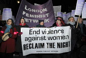 Young women march on Reclaim the Night rally in central London with banner End Violence Against Women. - Janina Struk - 22-11-2008
