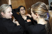 A female martial arts instructor gives instruction at a self defense workshop form women at BECTU womens conference. - Janina Struk - 22-11-2008