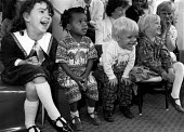 Children laughing at a performance given by a clown at a party. - Janina Struk - 20-12-1996