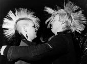A young punk couple dancing at a gig at a club in Sunderland with mohican haircuts - Janina Struk - 1980s,1987,ACE,ACE arts culture & entertainment,adult,adults,audience,AUDIENCES,cities,city,club,clubs,concert,concerts,couple,couples,Culture,dance,DANCER,DANCERS,dances,dancing,embrace,embraced,embr
