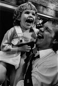 A happy father and daugher enjoying a laugh together. - Janina Struk - 03-05-1992