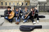 Boys sitting on a pavement playing the bandura in the centre of Kiev, Ukraine. - Janina Struk - 2010s,2012,ACE,adolescence,adolescent,adolescents,arts,baggar,band,bands,Bandurist,Bandurists,beg,beggar,beggars,BEGGER,begging,begs,boy,boys,busk,busker,buskers,busking,child,CHILDHOOD,children,citie