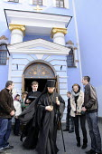 Onlookers stand aside as a Patriarch leaves St Michaels Monastery, Kiev, Ukraine. - Janina Struk - 14-04-2012