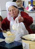 A woman weighing out sour cream at a market stall in Odessa. - Janina Struk - 2010s,2012,age,ageing population,dairy,EARNINGS,eastern Europe,EBF Economy,elderly,employed,employee,employees,employment,EQUALITY,Europe,food,FOODS,foodstuff,home produce,Income,INCOMES,inequality,jo