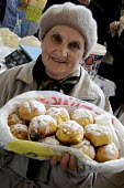 An elderly woman selling homemade cakes in the main market in Odessa, Ukraine. - Janina Struk - 2010s,2012,age,ageing population,baker bakers,buns,cakes,display,displays,EARNINGS,eastern Europe,EBF Economy,elderly,employee,employees,Employment,EQUALITY,Europe,female,food,FOODS,foodstuff,Income,I