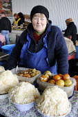 A woman selling cabbage, tomatoes and pickles in the main market in Odessa. - Janina Struk - 2010s,2012,display,displays,EARNINGS,eastern Europe,EBF Economy,employed,employee,employees,employment,EQUALITY,Europe,female,food,FOODS,foodstuff,Income,INCOMES,inequality,job,jobs,LBR,LBR Work,livin
