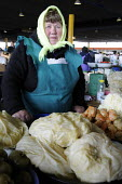 A market trader selling cabbage, tomatoes and cabbage rolls at the manin market in Odessa, Ukraine. - Janina Struk - 2010s,2012,age,ageing population,display,displays,EARNINGS,eastern Europe,EBF Economy,elderly,employed,employee,employees,employment,EQUALITY,Europe,female,food,FOODS,foodstuff,Income,INCOMES,inequali