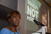 A black woman USDAW delegate speaking at Women's TUC, 2015 with an Equality not Poverty poster in the background. - Janina Struk - 12-03-2015