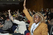Black woman NASUWT delgate voting at Women's TUC, 2015. - Janina Struk - 13-03-2015