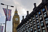 The Clock tower of Big Ben at the Palace of Westminster between Union Jack flags and the Portcullis House, the offices of MP's - John Sturrock - 28-07-2004