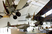 A Sopwith F1 Camel (top left) suspended above a de Havilland B35 in a view of the historic aircraft on display at the RAF Museum Hendon - John Sturrock - 24-09-2004