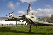 A Supermarine Spitfire and a Hawker Hurricane (foreground) historic aircraft from World War II, on display outside the RAF Museum Hendon - John Sturrock - 24-09-2004