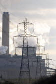 Late afternoon winter sunlight filters through steam rising from the cooling towers of Didcot Power Station, and silhouettes a line of electric pylons in the foreground - John Sturrock - 16-02-2005