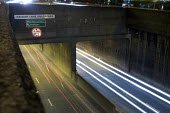 Trails from the lights of cars on the western side of the A40 underpass beneath the A406 North Circular Road at the Hanger Lane Gyratory system, at night - John Sturrock - 2000s,2005,at,AUTO,AUTOMOBILE,AUTOMOBILES,AUTOMOTIVE,blur,blurred,car,cars,cities,city,EBF Economy,flow,flowing,headlight,headlights,highway,journey,journeys,light,lights,movement,night time,road,road