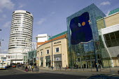 The New Street Station entrance to the Bull Ring shopping centre adorned by a painted glass art work, an example of the public art that is featured in redeveloped Birmingham city centre. The older Rot... - John Sturrock - 14-03-2005
