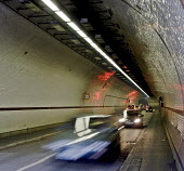 The blurred movement of traffic travelling from Shawell, north of the River Thames, London east end, through the Rotherhithe Tunnel to Rotherhithe in the south - John Sturrock - 30-03-2005