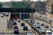 Heavy traffic travelling into and out of the Fore Street Tunnel, Edmonton, along the A406 North Circular Rd, in north east London - John Sturrock - 11-04-2005