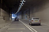 The driver's view of traffic travelling through the Fore Street Tunnel, Edmonton, along the A406 North Circular Rd, in north east London - John Sturrock - 11-04-2005