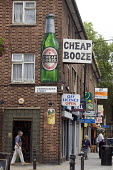 An Off License displaying a Cheap Booze sign in Hoxton, East London - John Sturrock - 30-07-2004
