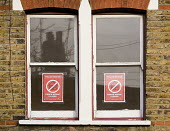 Notice in the window of a crack house closed by the police after a drugs raid in Ealing - John Sturrock - 30-07-2004
