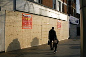 The silhouette of the golden arches is all that remains of McDonald's, a well known burger restaurant in the Broadway, West Ealing. now closed and boarded up. This was one of 25 UK branches due to clo... - John Sturrock - 23-03-2006
