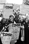 A protest of nurses, in uniform, from the Union COHSE, during wage negotiations in London, during the winter of discontent - 1979 - John Sturrock - 1970s,1979,activist,activists,against,CAMPAIGN,campaign campaigning,campaigner,campaigners,CAMPAIGNING,CAMPAIGNS,COHSE,DEMONSTRATING,DEMONSTRATION,DEMONSTRATIONS,dispute,disputes,EARNINGS,EQUALITY,Inc