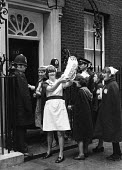 A delegation of nurses, in uniform, from the Union COHSE, outside No 10 Downing Street, during wage negotiations in London, during the winter of discontent 1979 One of the nurses holds up a doll marke... - John Sturrock - 1970s,1979,activist,activists,against,babies,baby,campaign,campaign campaigning,campaigner,campaigners,CAMPAIGNING,CAMPAIGNS,Child,CHILDHOOD,children,COHSE,DEMONSTRATING,demonstration,DEMONSTRATIONS,d