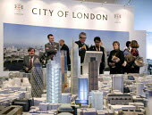 A model of London forms the centrepiece of the London marquee, at the MIPIM 2008 Cannes - The worlds real estate showcase for property professionals. - John Sturrock - 2000s,2008,AFFLUENCE,AFFLUENT,Bourgeoisie,business,businessman,businessmen,businessperson,businesswoman,businesswomen,capitalism,capitalist,cities,city,conference,conferences,corporate,development,dis