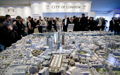 A model of London forms the centrepiece of the London marquee, at the MIPIM 2008 Cannes - The worlds real estate showcase for property professionals. - John Sturrock - 2000s,2008,ACE,AFFLUENCE,AFFLUENT,architecture,arts,BME minority ethnic,Bourgeoisie,buildings,business,businessman,businessmen,businessperson,businesswoman,businesswomen,capitalism,capitalist,cities,c
