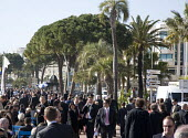 Crowds of delegates walking between the exhibition and hotels on the Boulevard De La Croisette, at the MIPIM 2008 Cannes - The worlds real estate showcase for property professionals. - John Sturrock - 11-03-2008
