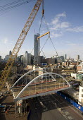Installation of a 350 tonne bridge for the East London Line extension by Britains biggest mobile crane over Shoreditch High Street, London - John Sturrock - ,2000s,2008,Balfour,Beatty,big,biggest,bow,bowstring,bridge,bridges,Carillion,cities,city,Construction Industry,crane,cranes,East,EBF economy,engineering,For,hoisted,Installation,installed,installing,