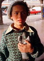 Roma child holding bird. Pristina, Kosovo. 1998 - Andrija Ilic - 1990s,1998,Balkan,balkans,BAME,BAMEs,BME,bmes,boy,boys,child,CHILDHOOD,children,diversity,ethnic,ethnicity,europe,gipsey,Gipsey Gipsy Gypsey,Gipsies,Gipsy,gypse,gypsey,Gypsie,gypsies,Gypsies Traveller
