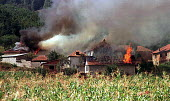 Villages burning following clashes between the Yugoslav army and the KLA. Pristina - Pech road, Kosovo. 1998 - Andrija Ilic - 01-07-1998