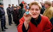Woman holding photograph of her missing son at demonstration by Serb families whose relatives have been kidnapped in Kosovo. Pristina, Kosovo. 1998 - Andrija Ilic - ,1990s,1998,activist,activists,adult,adults,Balkan,balkans,BAME,BAMEs,BME,bmes,CAMPAIGNING,CAMPAIGNS,conflict,conflicts,DEMONSTRATING,demonstration,diversity,ethnic,Ethnic Cleansing,ethnicity,europe,F