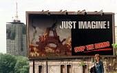 Anti war poster in front of building damaged by NATO bombing. Belgrade, Serbia. 1999. - Andrija Ilic - 01-07-1999