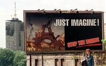 Anti war poster in front of building damaged by NATO bombing. Belgrade, Serbia. 1999. - Andrija Ilic - 1990s,1999,activist,activists,Anti War,Antiwar,Balkan,balkans,building,BUILDINGS,CAMPAIGN,campaigner,campaigners,CAMPAIGNING,CAMPAIGNS,conflict,conflicts,damaged,DEMONSTRATING,Demonstration,DEMONSTRAT