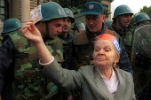 Elderly woman with Serb soldiers in Belgrade, Serbia. 2000 - Andrija Ilic - 2000,2000s,activist,activists,adult,adults,age,ageing population,armed forces,army,Balkan,balkans,CAMPAIGN,campaigner,campaigners,CAMPAIGNING,CAMPAIGNS,conflict,conflicts,DEMONSTRATING,DEMONSTRATION,d