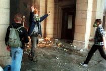 Demonstrators celebrating the fall of the Miloshevic regime. Belgrade, Serbia. 2000 - Andrija Ilic - 01-07-2000